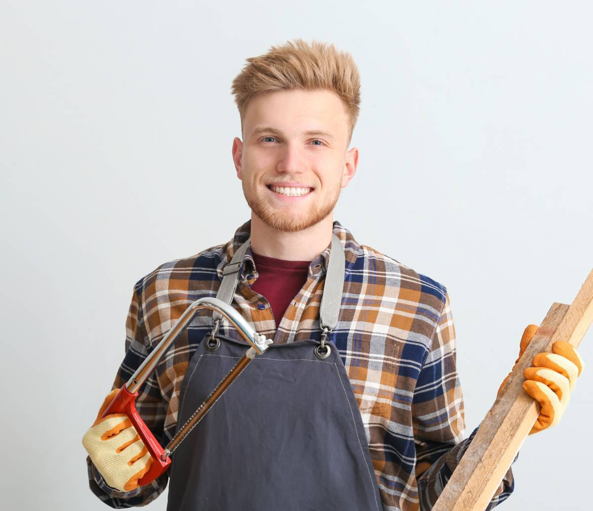 Male carpenter on grey background